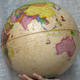A globe in hand presenting Australia and Asia